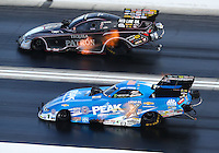 Oct 29, 2016; Las Vegas, NV, USA; NHRA funny car driver John Force (near) races alongside Alexis DeJoria during qualifying for the Toyota Nationals at The Strip at Las Vegas Motor Speedway. Mandatory Credit: Mark J. Rebilas-USA TODAY Sports