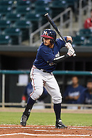 Mississippi Braves shortstop Gustavo Nunez (4) at bat during a game against the Montgomery Biscuits on April 21, 2014 at Riverwalk Stadium in Montgomery, Alabama.  Montgomery defeated Mississippi 6-2.  (Mike Janes/Four Seam Images)
