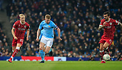 9th January 2018, Etihad Stadium, Manchester, England; Carabao Cup football, semi-final, 1st leg, Manchester City versus Bristol City; Kevin De Bruyne of Manchester City passes the ball away from Hordur Magnusson of Bristol City
