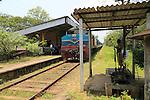 Train at small rural train station, Habarana, Sri Lanka, Asia,  worker operating signals