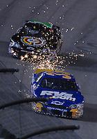 May 4, 2007; Richmond, VA, USA; Nascar Busch Series driver Tony Raines (33) sparks after blowing a tire during the Circuit City 250 at Richmond International Raceway. Mandatory Credit: Mark J. Rebilas