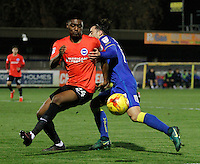 Brighton's Rohan Ince fends off AFC Wimbledon's Chris Whelpdale during the The Checkatrade Trophy match between AFC Wimbledon and Brighton & Hove Albion Under 21s at the Cherry Red Records Stadium, Kingston, England on 6 December 2016. Photo by Carlton Myrie / PRiME Media Images