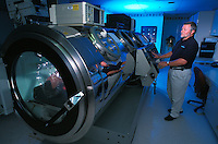 Technician with patient in Hyperbaric Chamber at Burn Center.