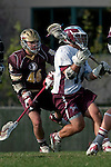 Los Angeles, CA 03/08/10 - Andrew Manglapus (LMU # 14) and Rolly O'Meilia (FSU # 46) in action during the Florida State-LMU MCLA interconference men's lacrosse game at Leavey Field (LMU).  Florida State defeated LMU 12-7.
