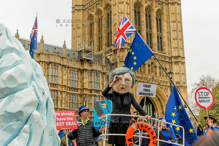 LONDON, ENGLAND - JANUARY 15: A demonstration featuring a paper mâché Theresa May head sailing towards an iceberg is staged by campaign group Avaaz outside the Houses of Parliament  on January 15, 2019 in London, England. Theresa May's Brexit deal finally reaches the House of Commons this evening and MPs will begin voting on it at 7pm. The Prime Minister has consistently said her's is the only deal that Brussels will entertain and urged support from Parliament to avoid the UK crashing out of the European Union with no deal. Photo Adamo Di Loreto