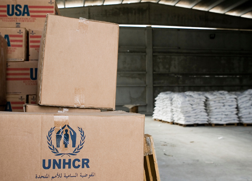 Boxes of aid material and bags of food aid sit in a warehouse at a United Nations High Comissioner for Refugees (UNHCR) registration and food distribution post on the outskirts of Damascus, Syria, November 19 2008. According to UNHCR, the post processed an average of 3000 new Iraqi refugees per month in 2008, down from a peak of 10 000 per month in late 2007. Photo: Ed Giles.