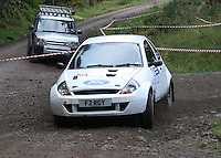Ian Forgan / Kathryn Forgan at Junction 6, on Special Stage 1 Craigvinean in the Colin McRae Forest Stages Rally 2012, Round 8 of the RAC MSA Scotish Rally Championship which was organised by Coltness Car Club and based in Aberfeldy on 5.10.12.