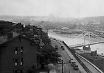 Pittsburgh PA:  View looking south towards the South Side and Monongahela River from the bluff at Duquesne University- 1932. View of the 10th Street bridge under construction and J&L Steel plant.