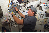In Earth Orbit - December 10, 2006 -- Astronaut William A. (Bill) Oefelein, STS-116 pilot, works at a control panel on the middeck of Space Shuttle Discovery during flight day two activities..Credit: NASA via CNP
