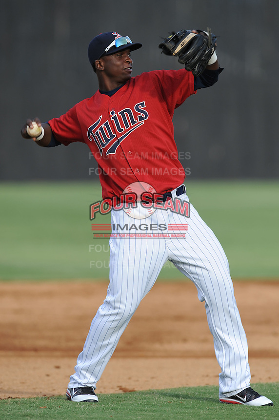 Elizabethton Twins third baseman Miguel Sano #11 warms up between innings during a game against the Bluefield Blue Jays at Joe O'Brien Field on June 21, 2011 in Elizabethton, Tennessee.  The game was delayed with the score 5-5.  (Tony Farlow/Four Seam Images)