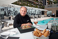 Joël Robuchon, chef and and restaurateur, poses for the photographer at Odyssey in the Hotel Metropole, Monte Carlo, Monaco, 22 May 2013. Odyssey is an exclusively alfresco dining experience and Joël Robuchon's third restaurant within the hotel. The wall frescoes and space concept were designed by Karl Lagerfeld.