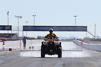 Feb 3, 2016; Chandler, AZ, USA; A member of the NHRA safety safari sprays VHT traction compound on the track during pre season testing at Wild Horse Pass Motorsports Park. Mandatory Credit: Mark J. Rebilas-USA TODAY Sports