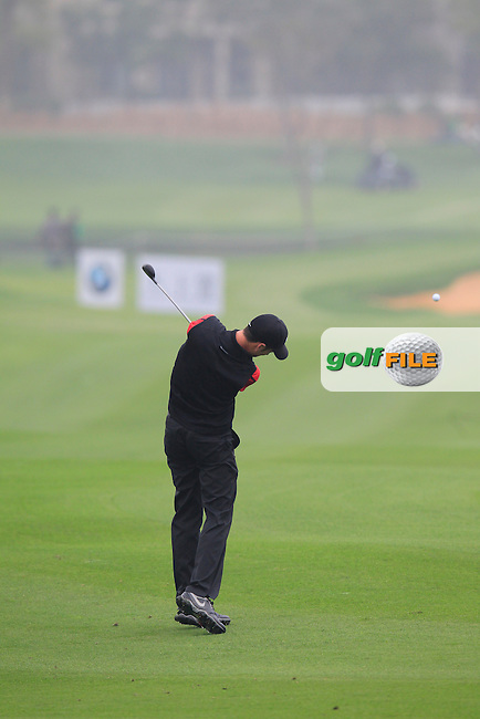 Ross Fisher (ENG) plays his 2nd shot on the 5th hole during Saturay's Round 3 of the 2014 BMW Masters held at Lake Malaren, Shanghai, China. 1st November 2014.<br /> Picture: Eoin Clarke www.golffile.ie
