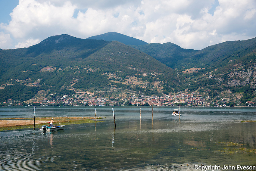 Lake Iseo or Lago d'Iseo or Sebino is the fourth largest lake in Lombardy, Italy, fed by the Oglio river. It is in the north of the country in the Val Camonica area, near the cities of Brescia and Bergamo.