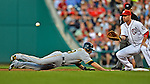 17 May 2012: Pittsburgh Pirates infielder Neil Walker dives safely back to first during game action against the Washington Nationals at Nationals Park in Washington, DC. The Pirates defeated the Nationals 5-3 in the second game of their 2-game series. Mandatory Credit: Ed Wolfstein Photo