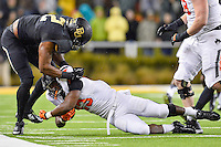 Baylor defensive end Shawn Oakman (2) brings down Oklahoma State running back Rennie Childs (23) during first half of an NCAA football game, Saturday, November 22, 2014 in Waco, Tex. Baylor leads 28-14 at the halftime. (Mo Khursheed/TFV Media via AP Images)