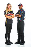 Jan 11, 2018; Brownsburg, IN, USA; NHRA top fuel driver Leah Pritchett (left) and Antron Brown pose for a portrait during a photo shoot at Don Schumacher Racing. Mandatory Credit: Mark J. Rebilas-USA TODAY Sports