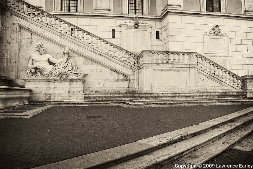 Michaelangelo's famous design for the piazza on Capitoline Hill included a double stairway, part of which is pictured here.  Also in the photograph is one of two ancient statues of river gods, this one personifying the Tiber, that were placed there by Michaelangelo.