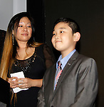 Christina Yi & son - 19th Annual HoG New York - Hearts of Gold Gala 2015 celebrating twenty-one years of support for New York City homeless mothers and their children founded by Deborah Koenigsberger on November 5, 2015 at NASDAQ MarketSite, New York City, New York. (Photo by Sue Coflin/Max Photos)