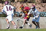 Los Angeles, CA 02/20/10 - Alec Paul (LMU # 7) and Jeff Gleiberman (USC # 13) in action during the USC-Loyola Marymount University MCLA/SLC divisional game at Leavey Field (LMU).  LMU defeated USC 10-7.