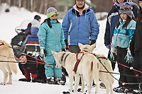 Ruby residents watch Jim Lanier's dog as he checks in at Ruby on Friday during the 2008 Iditarod