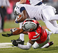 Ohio State Buckeyes cornerback Bradley Roby (1) takes down Penn State Nittany Lions wide receiver Eugene Lewis (7) in second half action at Ohio Stadium on October 26, 2013.  (Chris Russell/Dispatch Photo)