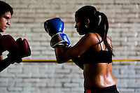 Geraldin Hamann, a young Colombian boxer, practices sparring with a male team mate in the boxing gym in Cali, Colombia, 26 June 2013. During the recent years, Kina Malpartida, a Peruvian female professional boxer, has won the World Championship title several times and so she has become a sporting idol and an inspiration for a generation of young girls throughout Latin America. Working out hard in poorly equipped gyms, they dream of becoming a boxing star. The Cauca Valley and the Caribbean coast are believed to be a home of the most talented female boxers in Colombia.