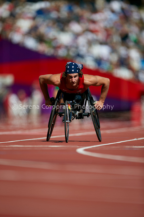 Joshua George finishes his heat of the men's T53 200m at the London Paralympic Games - Athletics 7.9.12
