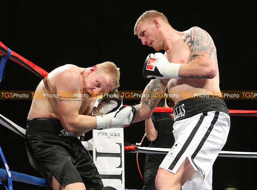 Tom Dallas (white shorts) defeats Lee Swaby in a Heavyweight boxing contest at Goresbrook Leisure Centre, Dagenham, promoted by Frank Maloney - 14/05/10 - MANDATORY CREDIT: Gavin Ellis/TGSPHOTO - Self billing applies where appropriate - Tel: 0845 094 6026