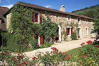 The exterior of Le Pressoir, a 14th century mill converted into holiday lets in the grounds of the Chateau de la Bourlie in the Dordogne