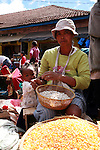 A woman with a daughter selling white beans at the Analakely market in Antananarivo in Madagascar