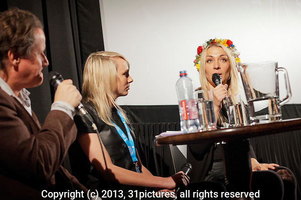 The Netherlands, Amsterdam, 27 November 2013. The 26th International Documentary Film Festival Amsterdam - IDFA 2013. Screening Ukraine is not a Brothel in Tuschinski Theater. QnA after, from left; moderator Harm Ede Botje, director Kitty Green, Inna Shevchenko (FEMEN, in film). Photo: 31pictures.nl / (c) 2013, www.31pictures.nl
