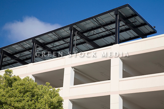 A close-up of this public parking garage in downtown Mountain View that has a 90KW (kilowatt) solar panel array on the roof that doubles as a sun shade for parked cars. Mountain view, California, USA