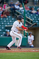 Rochester Red Wings left fielder Zack Granite (1) follows through on a swing during a game against the Pawtucket Red Sox on May 19, 2018 at Frontier Field in Rochester, New York.  Rochester defeated Pawtucket 2-1.  (Mike Janes/Four Seam Images)