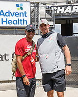 ORLANDO, FL - SEPTEMBER 14: Tiger Woods poses for a picture with K.J. Costello #3 of the Stanford Cardinal during a game between Stanford Cardinal and UCF Knights at Spectrum Stadium on September 14, 2019 in Orlando, Florida.