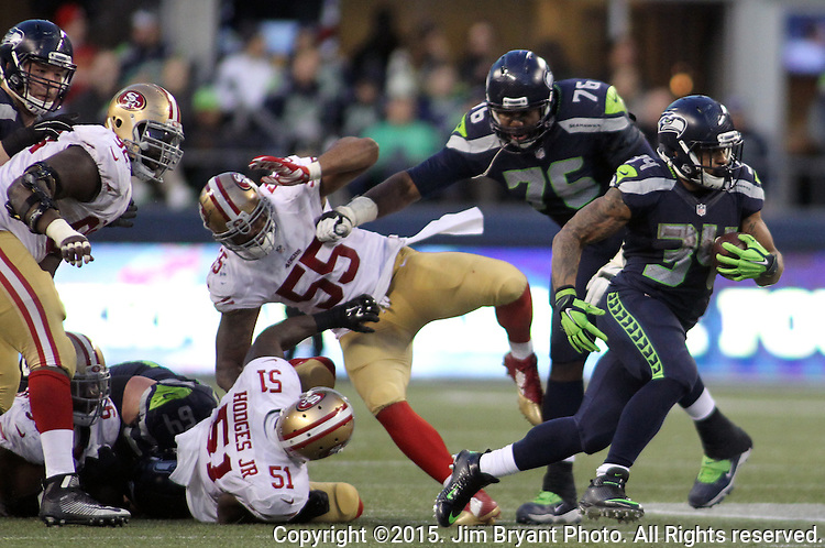 Seattle Seahawks running back Thomas Rawls (34) rushes agains the San Francisco 49ers at CenturyLink Field in Seattle, Washington on November 22, 2015.  The Seahawks beat the 49ers 29-13.   ©2015. Jim Bryant Photo. All RIghts Reserved.