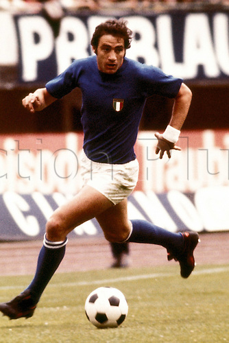 23.06.1974 Giorgio Chinaglia (Italy) goes forward with the ball.  The former Italy, Lazio and New York Cosmos star died of complications from a heart attack at his home in Naples, Florida. He was 65.
