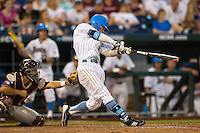 UCLA outfielder Eric Filia (4) follows through on his swing against the Mississippi State Bulldogs during the 2013 Men's College World Series Final on June 25, 2013 at TD Ameritrade Park in Omaha, Nebraska. The Bruins defeated the Bulldogs 8-0, winning the National Championship. (Andrew Woolley/Four Seam Images)