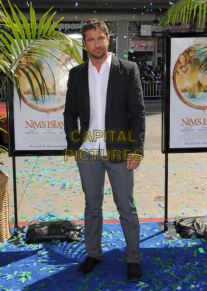 GERARD BUTLER .Attends Fox Walden's World Premiere of Nim's Island held at The Grauman's Chinese Theatre in Hollywood, California, USA, March 30th 2008                                                                     full length grey gray trousers white shirt black suit jacket hand in pocket.CAP/DVS.©Debbie VanStory/Capital Pictures