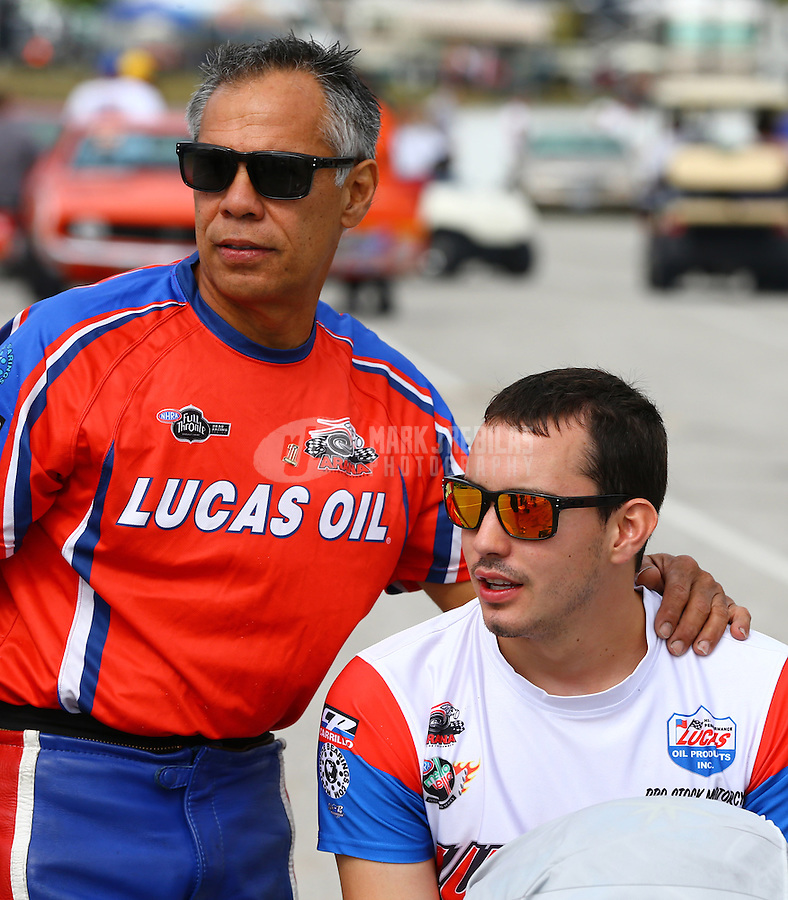 Sept. 1, 2013; Clermont, IN, USA: NHRA pro stock motorcycle rider Hector Arana Sr (left) with son Adam Arana during qualifying for the US Nationals at Lucas Oil Raceway. Mandatory Credit: Mark J. Rebilas-