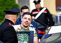 Walter Mallo is Escorted by police officier after his arrest. He is one of the so-called BabyBoss leaders of the new clan fighting for control of the drug market in Naples