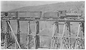 RGS 2-8-0 #19 on Bridge 43-A while B&amp;B supplies are lowered to the base for maintenance.<br /> RGS  Ames, CO  Taken by Virden, Walter - ca. 1920