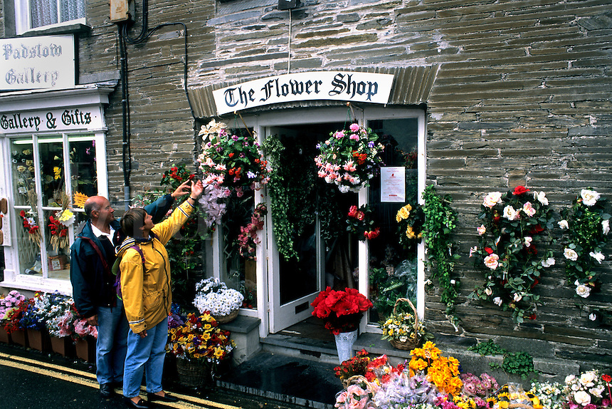 Colorful flower shop with tourists in Cornwall England