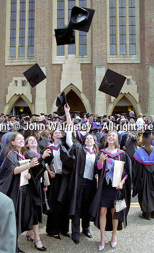 New graduates tossing their mortarboards, Graduation Celebrations at Guildford Cathedral.