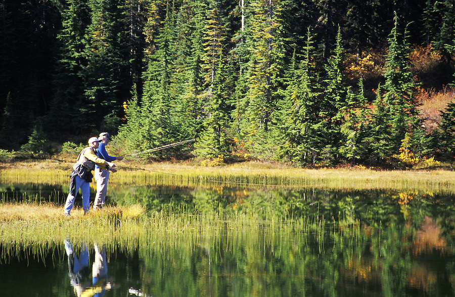 Father and son fly fishing subalpine lake, Grace Lakes, Stevens Pass, Cascade Mountains, Washington