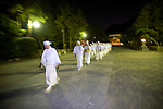 "Shrine priests and officials make their way along the Dankazura approach road of the Tsurugaoka Hachimangu shrine on their way to Yuhigahama beach to perform a rite known as ""hamaorisai"" at the start of the 3-day Reitaisai festival in Kamakura, Japan on  14 Sept. 2012.  During the ritual the priests collect seaweed from the sea and decorate the shrine with the rewards of their early morning endeavors. Photographer: Robert Gilhooly"