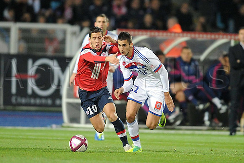 23.10.2011. Lille, France.   Football Lille versus Lyon, French League 1.  Eden Hazard Lille and Gonalons Lyon  Mandatory credit: ActionPlus