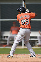 Oswill Lartiguez (89) of the Baltimore Orioles organization during a minor league spring training camp day game on March 23, 2014 at Buck O'Neil Complex in Sarasota, Florida.  (Mike Janes/Four Seam Images)