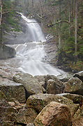 Bridal Veil Falls in Franconia, New Hampshire on a foggy and rainy spring day. These falls are located on Coppermine Brook, and when the brook is running high this waterfall is breathtaking.