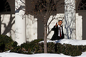 Washington, DC - December 24, 2009 -- United States President Barack Obama walks from the Oval Office to the White House residence in Washington, D.C., U.S., on Thursday, December 24, 2009. .Credit: Brendan Hoffman / Pool via CNP